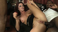 Fucked by the two black dicks at the same time, the hottie sighs with pleasure
