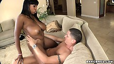 Big tits ebony babe Maserati riding a big white cock in an interracial fuck scene