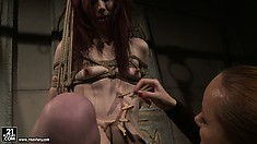 Redhead bound by ropes gets teased and tortured by her mistress