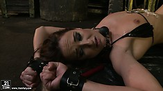 Kathia pours the hot wax over her and ties her legs up in the air