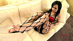 Sexy brunette provides a seductive show as she prances around in her fishnet stockings