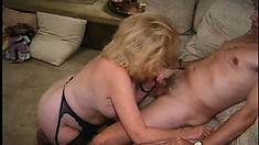 Mature fatty in a garter belt works her skills on a younger dick