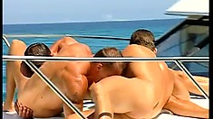 It's a gay play day on the water with a group of hunks in love with dick
