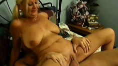 Busty mature blonde has a stud satisfying her needs in a hotel room
