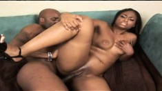 Sultry ebony girl with sexy long legs knows her way around a black rod
