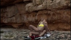 Skinny blonde has her boyfriend fucking her shaved pussy on the beach