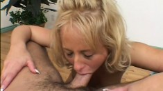 Down on her knees, a cute blonde has her hot lips and her big tits pleasing a long rod