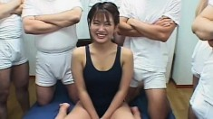 Sexy Asian tart gets her tight body fondled by a bunch of horny dudes