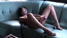 Short-haired Asian tart enjoys teasing by rubbing her smooth twat