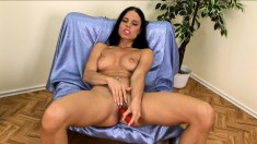 Mesmerizing brunette Alex drives a red dildo in and out of her snatch