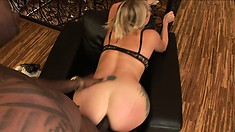 Inked sex goddess Adrianna Nicole gets deeply pounded by a black man