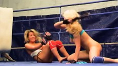 Anita Hengher and Bianca Arden wrestle to be on top while eating