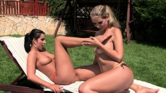 Blonde and brunette lesbians devour each other's cunts in the garden