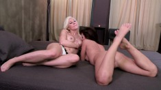 Blonde and brunette beauties sharing their passion for hot lesbian sex