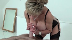Mature and busty blonde seductress feeds her sex addiction in a steamy 69 session
