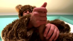 Muscled furry takes off his bear suit to fist-pump his hard cock