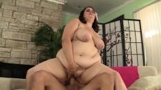 Plumper brunette gets on top of a hard pole and fucks it with fervor