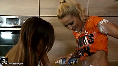 Two babes in the kitchen are mucking it up and having a food fight