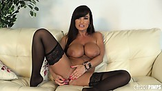 Busty cougar Lisa Ann focuses on working her pussy into an orgasm