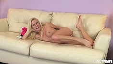Thin blonde Elaina Raye poses on the couch and stands up to show off