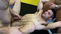 Lying On His Back, The Young Stud Enjoys A Deep Fucking While Sucking Another Rod