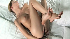 Every thrust of that sex toy in her holes makes her whole body tremble with delight