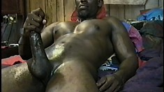 Black hunk strokes his big black shaft until it explodes with pleasure