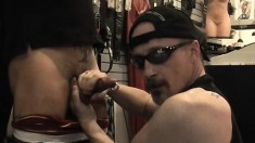 Horny gay dude whips out his wang for some sucking in the sex shop