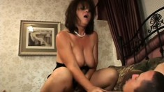 Chubby housewife in a black dress shakes her big ass on her man