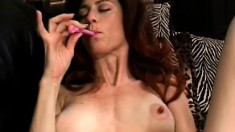 Lonely milf spreads her long legs and takes her shaved pussy to orgasm