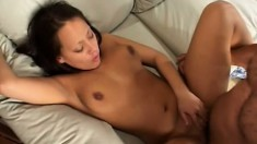 A hot young babe with a great pair of tits rides a throbbing cock
