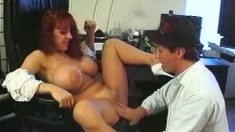 Redhead with big hooters is in need of a long dick drilling her cunt