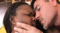 Voluptuous black chick has a horny white dude punishing her juicy cunt