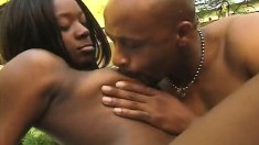 Lusty black chick lets this guy plug both her holes while outdoors
