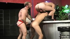 Sexy stripper is joined by two lustful gay studs for a wild threesome