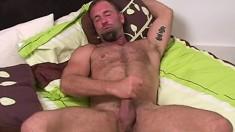 Experienced stud jerks off his large pole and enjoys intense pleasure