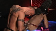 Horny hunk in a red jockstrap takes his buddy's fist deep in his ass
