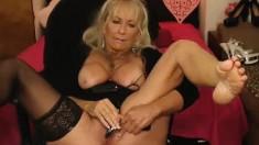 Blonde granny with glasses teasing on webcam